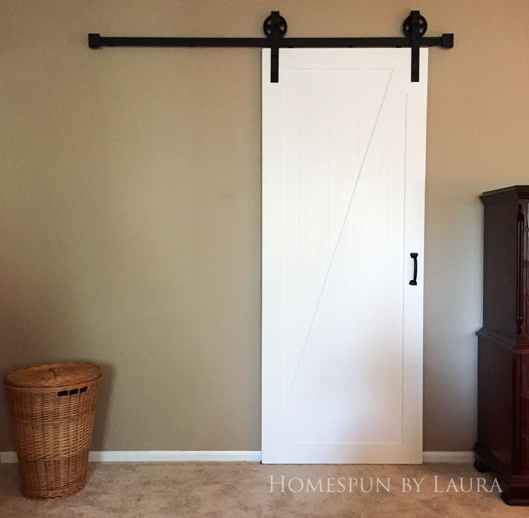 Master bedroom refresh   Homespun by Laura   The master bathroom: Our DIY barn door gives so much more space to our tiny bathroom!