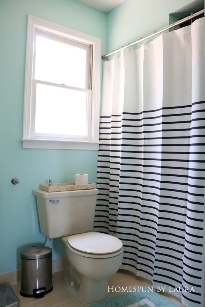 The $200 Master Bathroom Refresh   Homespun by Laura   A new shower curtain configuration changed the feel of the room.