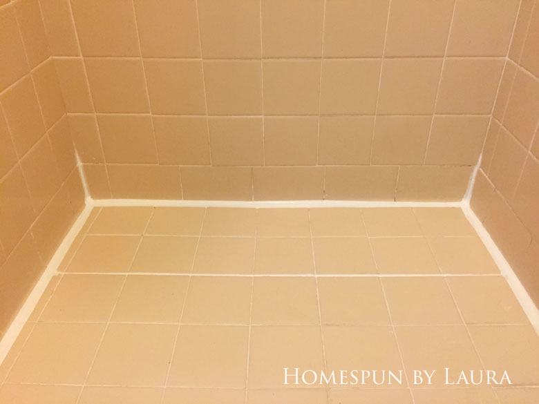 The $200 Master Bathroom Refresh   Homespun by Laura   Removing the old caulk and replacing it with fresh, clean lines makes an instant impact.