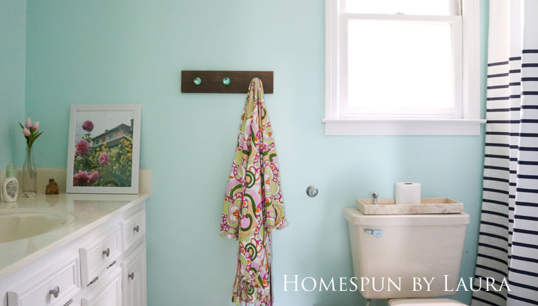 The $200 Master Bathroom Refresh   Homespun by Laura   The After: DIY shelf made with Liberty Hardware faceted glass knobs