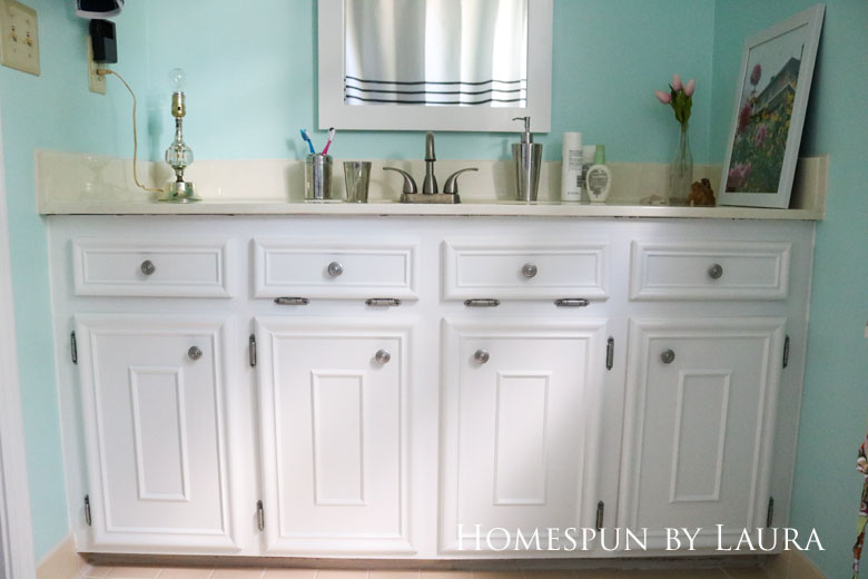 The $200 Master Bathroom Refresh   Homespun by Laura   Painted vanity and spray painted knobs brighten the space for free