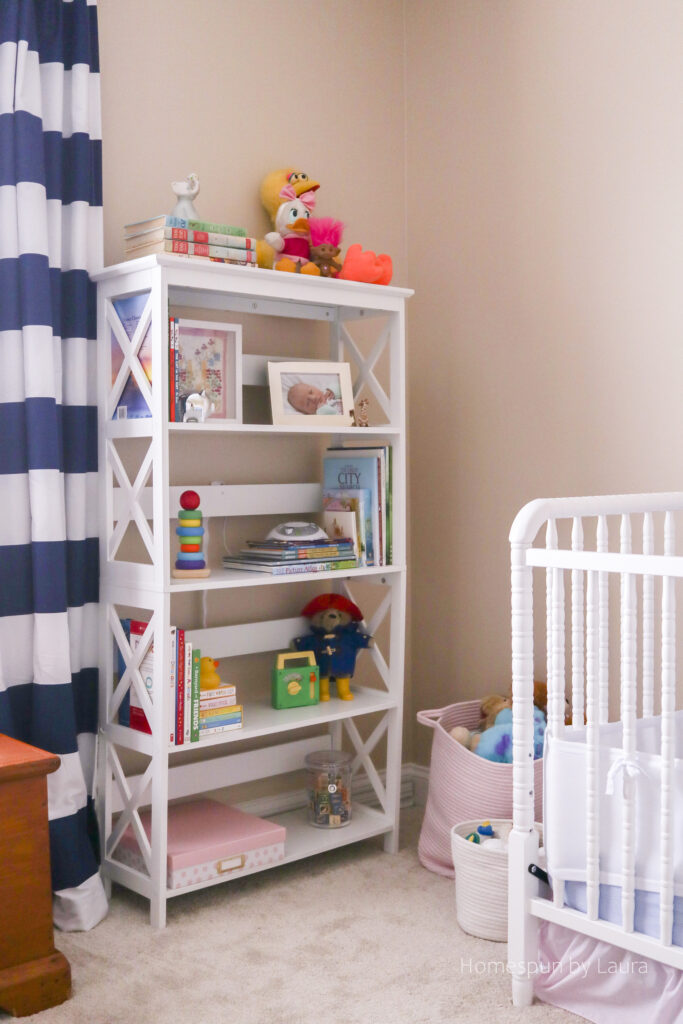 vintage toy nursery reveal - using mom and dad's childhood toys to decorate a nursery; pops of pink make it a pretty, cozy, and feminine space.