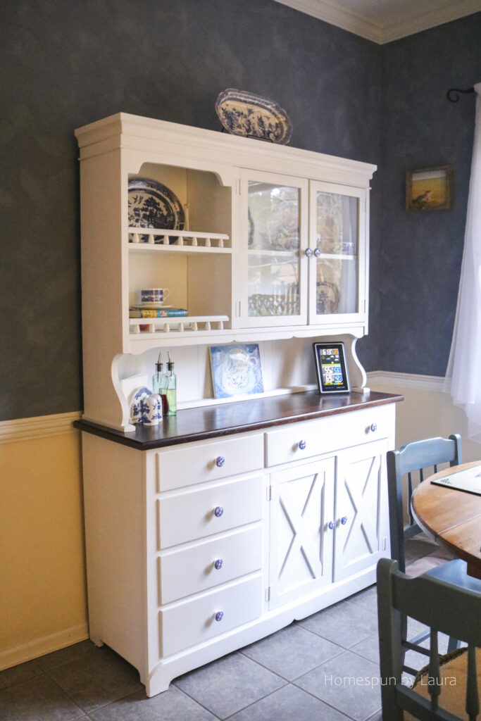 DIY white painted hutch with blue and white dishes